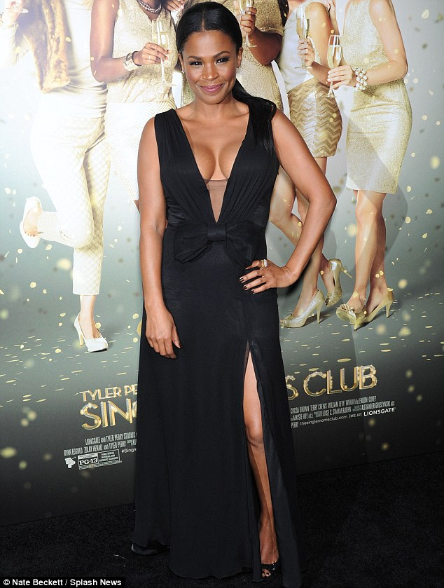 Bust on show: Nia Long made a memorable entrance in this daring dress at the premiere of The Single Moms Club in Los Angeles on Monday