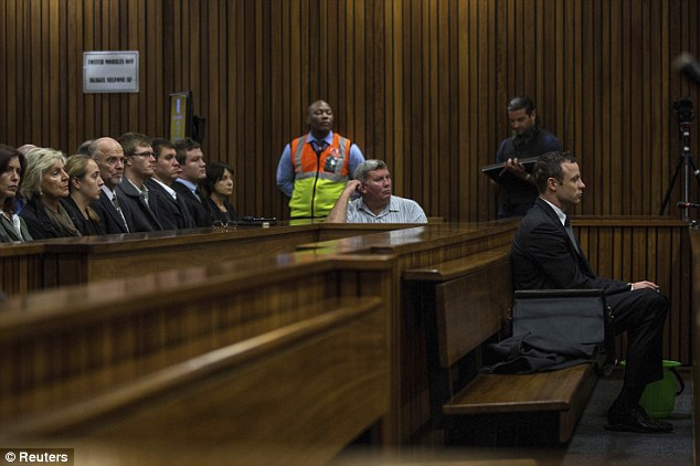 Calm: Pistorius appeared more composed than he was yesterday when he retched in the dock a number of times during testimony from the pathologist who carried out the post mortem on Miss Steenkamp
