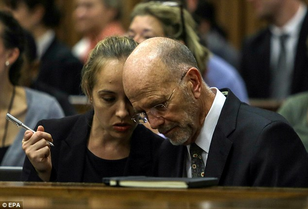 Family: Pistorius's uncle Arnold listens to a friend or relative in the public gallery of the court