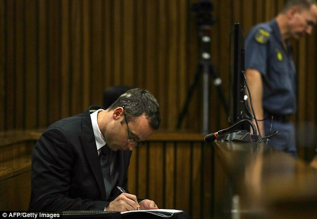 Engaging with the evidence: Pistorius takes notes as witnesses testify during the hearing