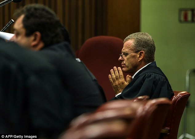 Making the state's case: Prosecutor Gerrie Nel listens to cross-examination by his counterpart Barry Roux