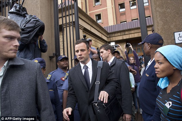 Over for another day: Pistorius leaves court at the end of the seventh day of his murder trial