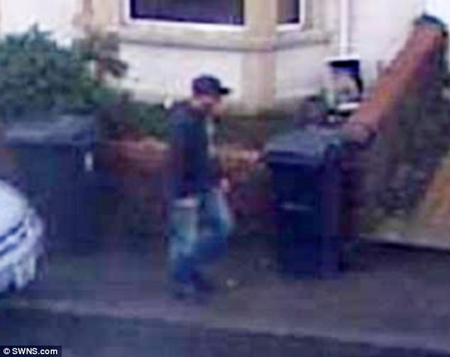 Appeal: This CCTV image has been released by police of a male suspect walking near Ms Taylor's home