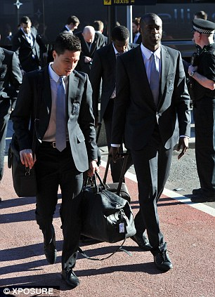 Focused: Samir Nasri and Yaya Toure walk in to the airport together