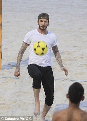 Still got it: David Beckham plays football on the Rio beach