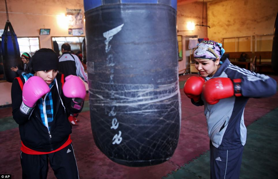 The boxers train in a cavernous, sparsely furnished room in Kabul, Afghanistan