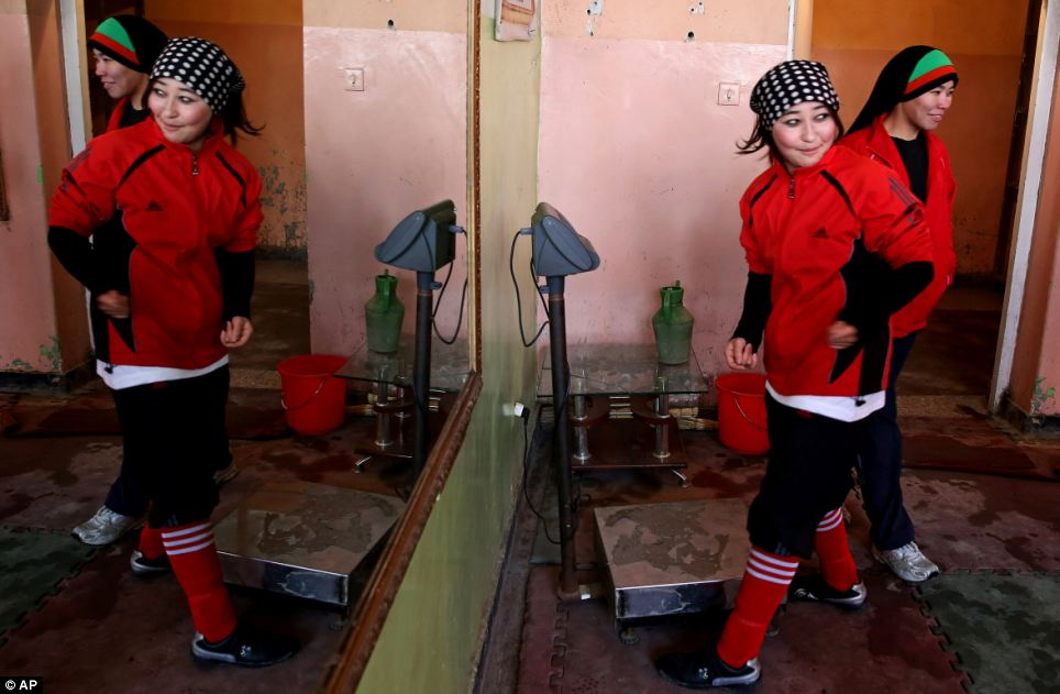 Afghan women boxers arrive for practice at the Kabul Stadium boxing club