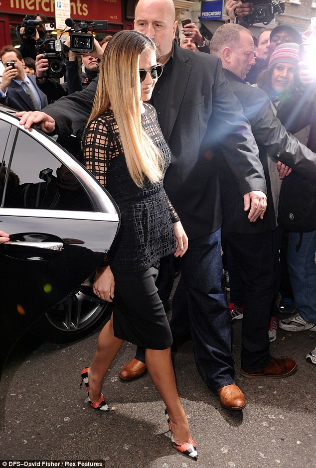 Golden girl: Cheryl looked stylish in her black peplum dressand heels as she prepared to re-enter the X Factor fray
