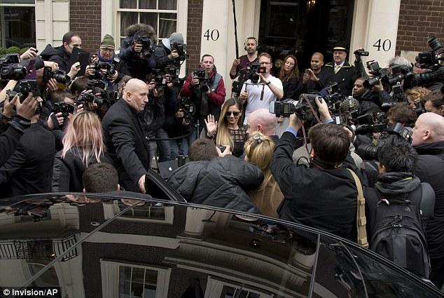 Camera swarm: Hundreds of photographers clamoured to snap Cheryl