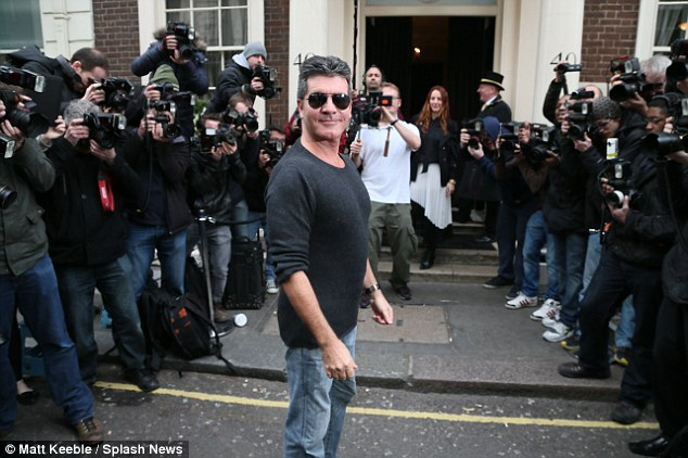 Best of frenemies: Simon and Cheryl have very publicly moved on and are looking forward to a new season of The X Factor