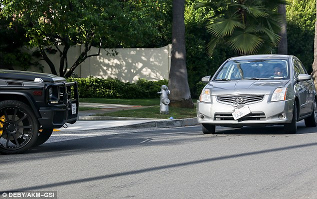 Collision: Kim's car is seen stopped at where the minor crash into a Nissan Sentra took place