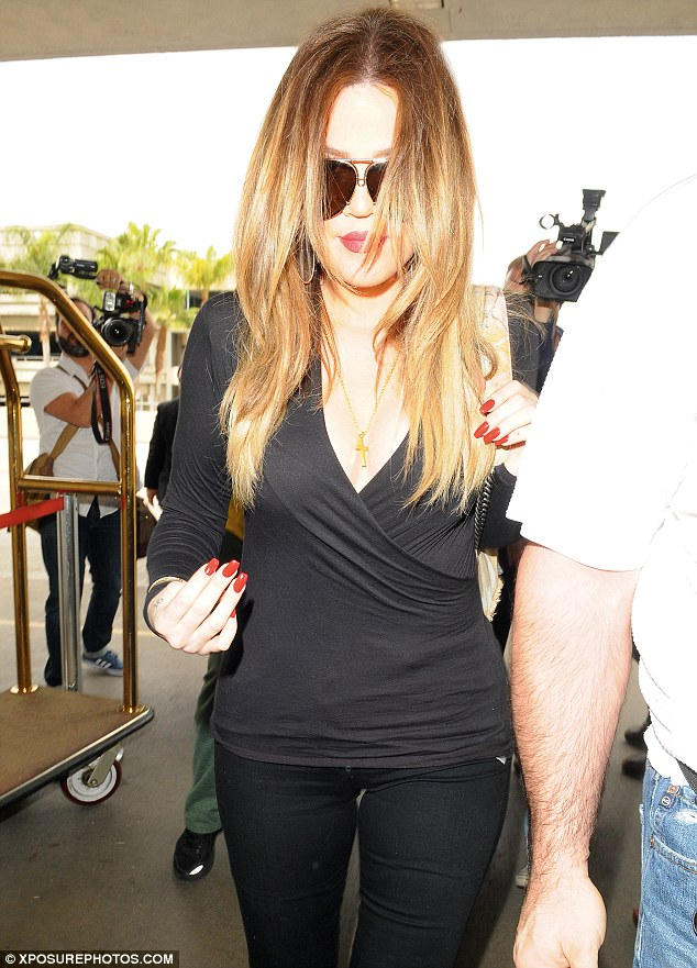 Sisterly support: Khloe Kardashian joined since Kim as they both were seen at LAX on Tuesday
