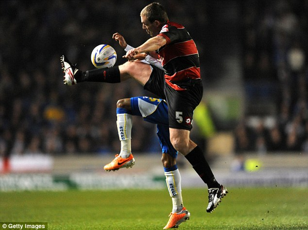 Away: QPR defender Richard Dunne clears the ball away from Brighton's Lingard
