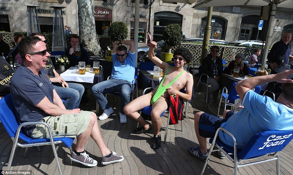 """Swimwear: One fan bears all for the cameras in a cafe with his Borat-style """"mankini"""""""