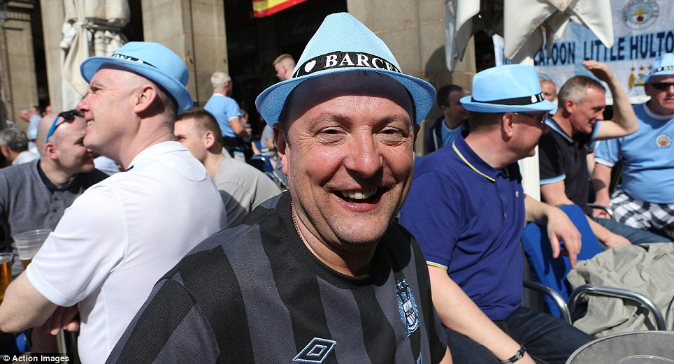 """Lads on tour: The fans don their shirts and City-themed """"I Love Barcelona"""" hats for their day out before the game"""