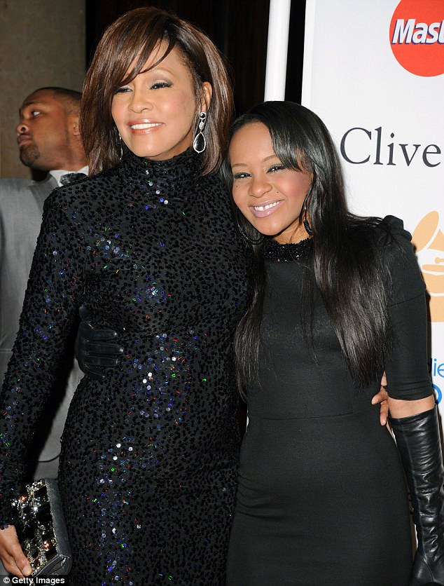 Mother and daughter: Bobbi, shown with mother Whitney in 2011 in Los Angeles, grew up with her husband Nick after her mother took him in at age 12