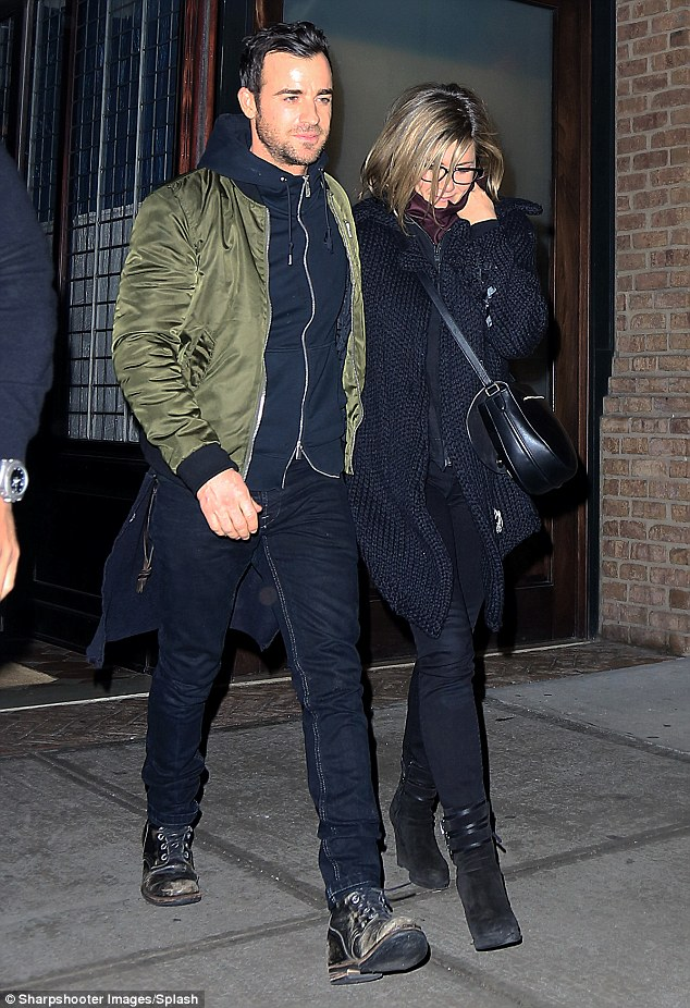 Lovers: The pair looked every inch the perfect couple as she strolled down the path hand-in-hand
