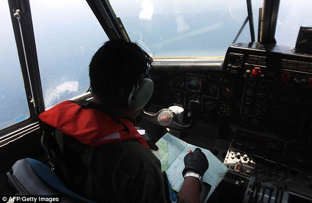 An Indonesian Navy pilot conducts an aerial search for the missing flight