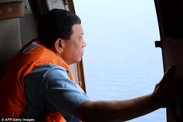 Vietnam Air Force Deputy Commander General Do Minh Tuan looking out from the door of a Russian-made MI-171 helicopter during a search flight some 200km off the southern Vietnamese waters