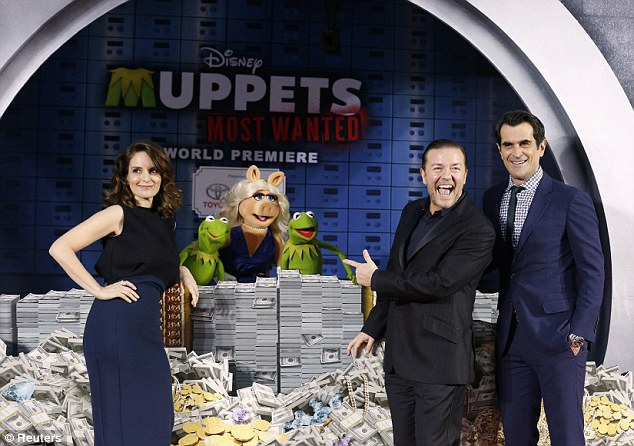 Goofing around: Cast members Ricky Gervais, Tina Fey (left) and Ty Burrell pose with the characters of Constantine (second left) and Miss Piggy and Kermit