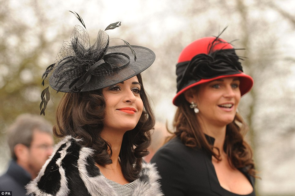 Lovely: Racegoers Tonie Bentley and Sara Walker show off their impressive hats and cosy fur collared coats as they arrive for Ladies Day at Cheltenham Festival