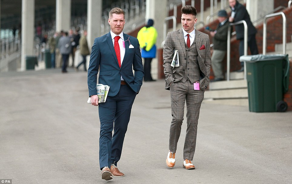 Dapper: The tweed suited gentlemen arriving at the races gave the ladies a run for their money in the style stakes thanks to natty accessories such as two tone brogues