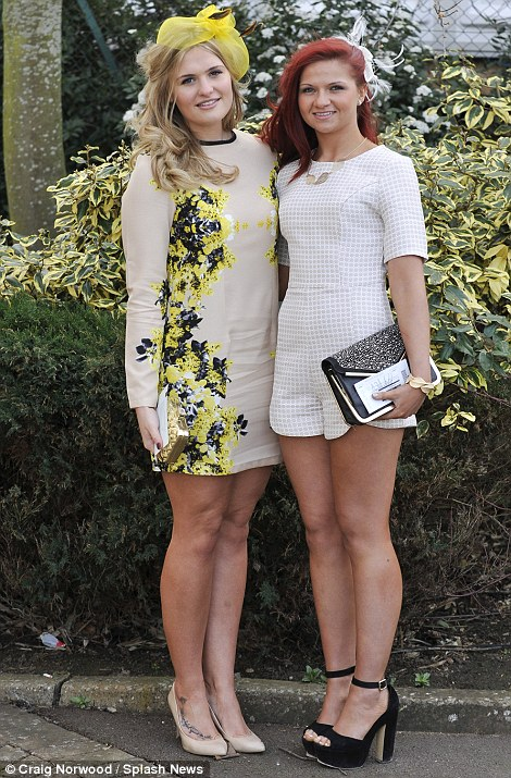 A pair of prettily dressed racegoers