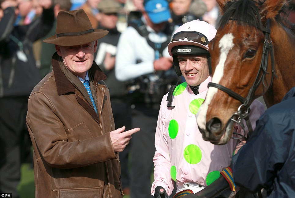 Overjoyed: Jockey Ruby Walsh celebrates with trainer Willie Mullins after riding Faugheen to victory in the Neptune Investment Management Novices' Hurdle