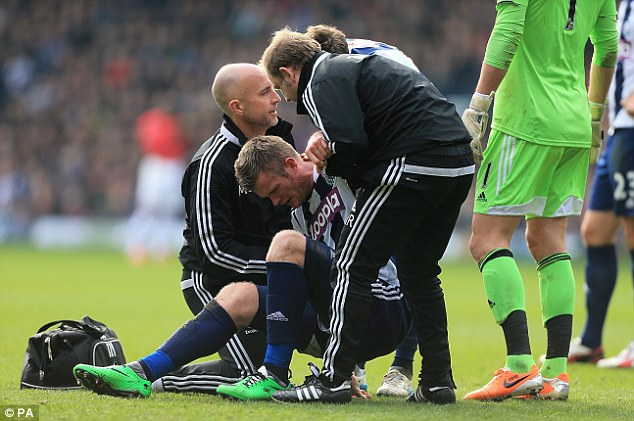 Bearing the brunt: West Brom captain Chris Brunt (centre) is out for five to six weeks with a knee injury