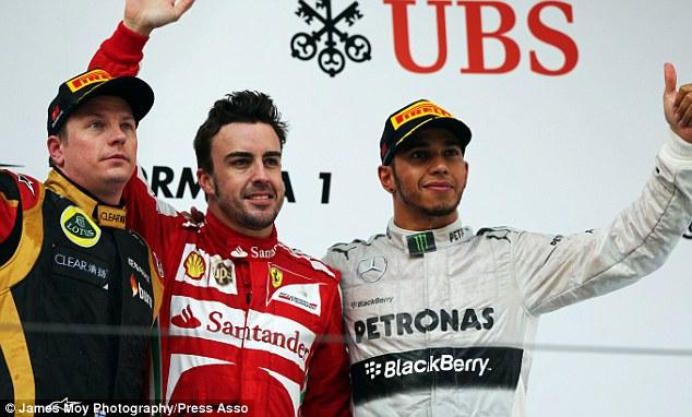 Team-mates: Raikkonen (left) has returned to Ferrari and will partner Alonso for the new F1 season