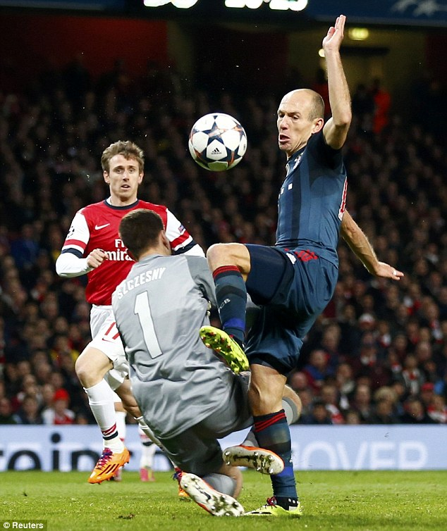 Defining moment: Robben won a penalty for Bayern in the first leg at the Emirates after goalkeeper Wojciech Szczesny brought him down and was sent off