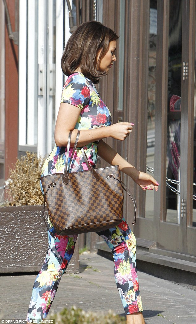 Accessorize all areas: The reality star carried a Louis Vuitton tote with her and wore black stiletto heels