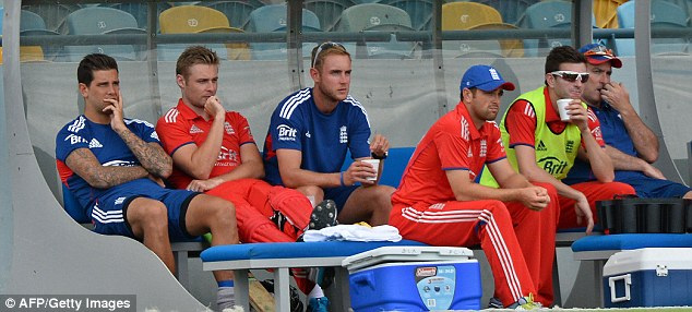 Bench duty: Broad (third left) could only watch as England fell to another defeat by West Indies