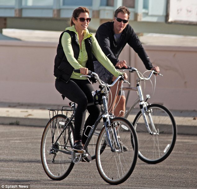 Flash-forward: Now 48, Ms Crawford has two children with husband of 16 years Rande Gerber (shown together here riding bikes earlier in March)