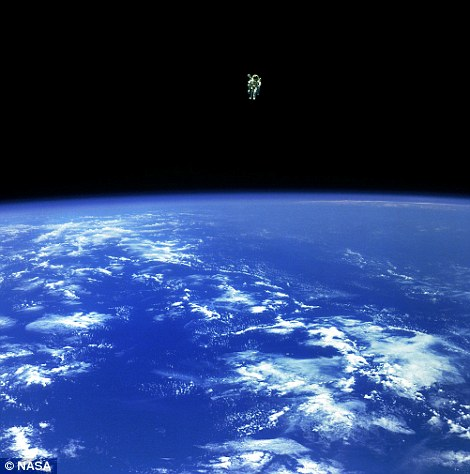 Floating in a most peculiar way: An astronaut floats above the earth