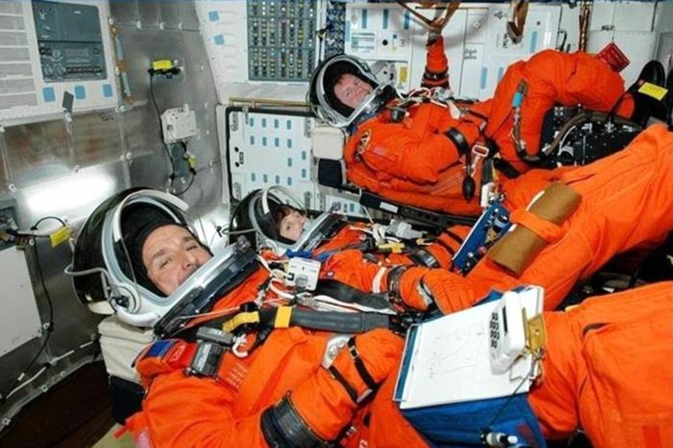 On a mission: Jon's team on their way into space. 'If I had the money, I¿d probably go every week, he says of space tourism
