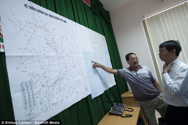 An official points to a map at the rescue command office on Phu Quoc Island, Vietnam