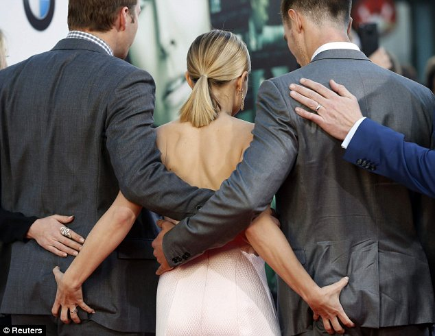 Firm hold: Kristen grabbed on to Jason and Ryan's butts as the whole cast posed for photos