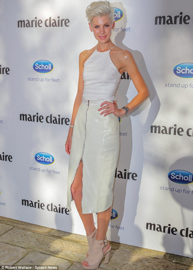 Well hidden: The model's feet were clad in a trendy pair of tan heeled boots when she arrived on the red carpet