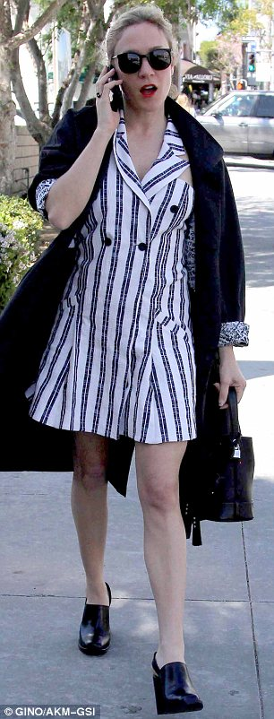 Stars in stripes: It wasn't easy to pull off but Chloe looked great in a white double-breasted shirt dress with blue stripes