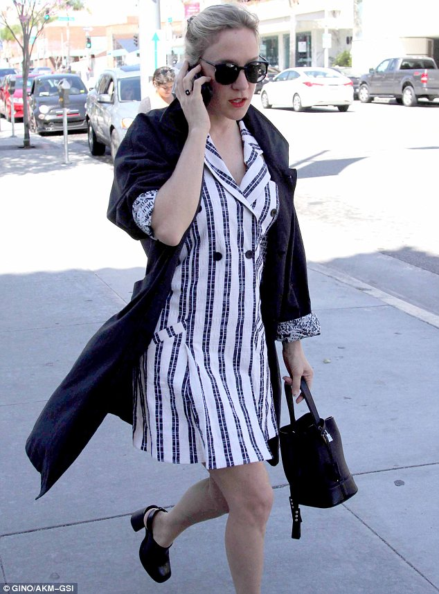 Always stylish: The 39-year-old also sported a black coat with printed lining, large sunglasses and red lipstick