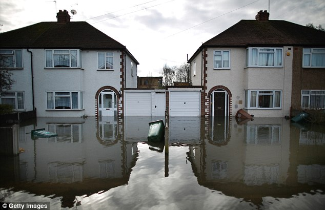Flooded: Homeowners, such as those in Staines-upon-Thames (pictured)  are expected to receive an estimated £276million, according to the latest figures by the Association of British Insurers