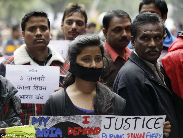 Indian protesters hold banners and wear black ribbons during a rally in New Delhi in December 2012, following the cremation of the victim in the Indian capital