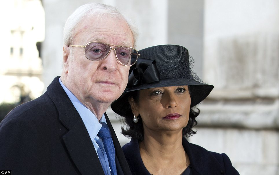 Star: Michael Caine and his wife Shakira outside the service