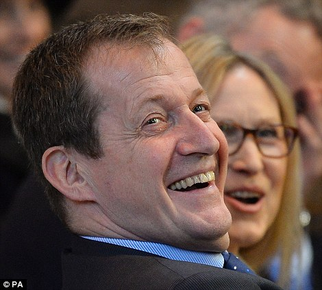 Alastair Campbell and other guests laugh during the memorial service