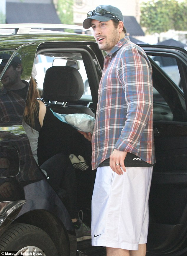Doting daddy: Hollywood star Jason Biggs wasspotted driving his young family around Los Angeles, on Wednesday