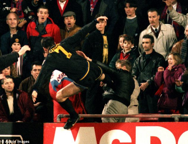Cantona jumps into the crowd for his infamous kung-fu kick in 1995
