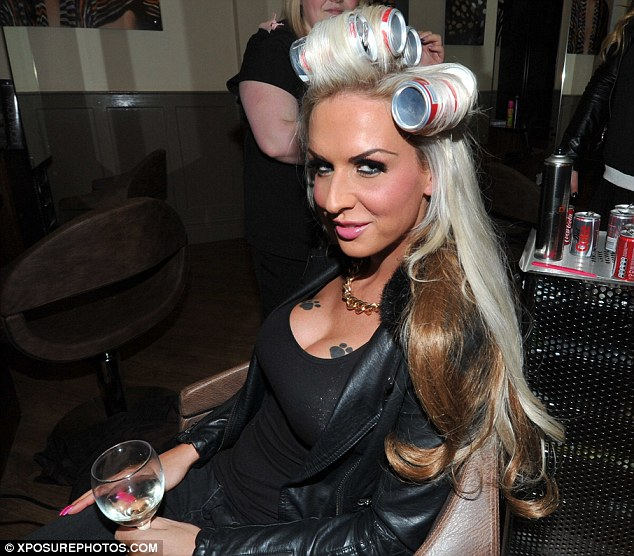 At the salon:  The transsexual star filmed a part of the show inside Bleach hair salon, using coke cans for rollers