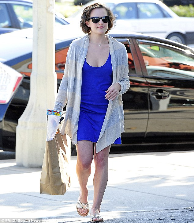Blue beauty: Elisabeth Moss sported a simple electric blue dress and sandals with long pastel striped cardigan as she headed for a day's pet shopping in West Hollywood on Thursday