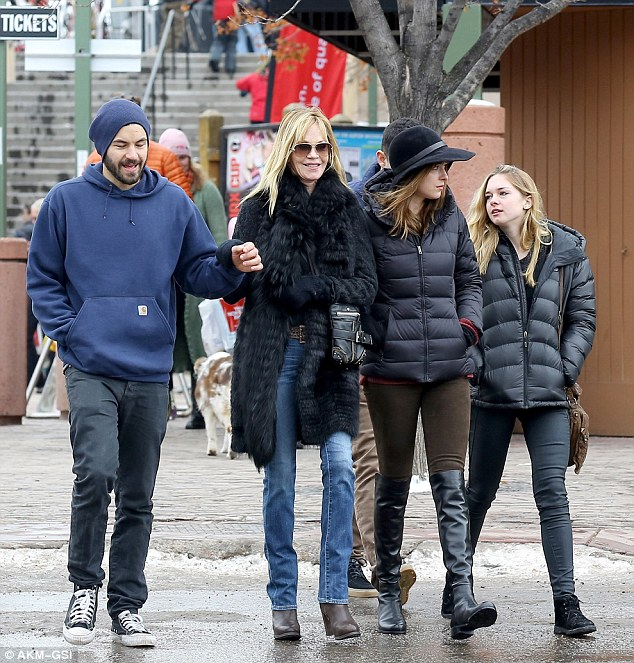 'My kids are almost grown. I'm getting divorced. I'm just happy!' The former couple are parents to daughter Stella (R), 17, and she has a son Alexander (L), 28, and daughter Dakota (M), 24, from previous marriages